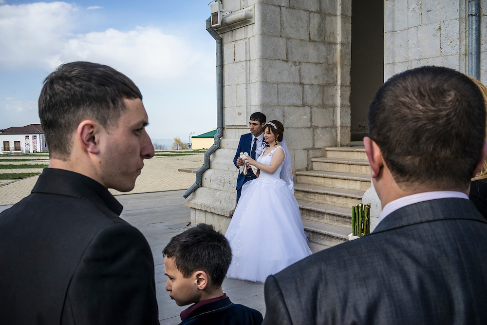 SHUSHI, NAGORNO-KARABAKH - APRIL 18: Groom Davit Simonyan, 24, and bride Shogher Hovsepyan, 25, prepare to release birds after their wedding at Ghazanchetsots church on April 18, 2015 in Shushi, Nagorno-Karabakh. Since signing a ceasefire in a war with Azerbaijan in 1994, Nagorno-Karabakh, officially part of Azerbaijan, has functioned as a self-declared independent republic and de facto part of Armenia, with hostilities along the line of contact between Nagorno-Karabakh and Azerbaijan occasionally flaring up and causing casualties. (Photo by Brendan Hoffman/Getty Images) *** Local Caption *** Davit Simonyan;Shogher Hovsepyan