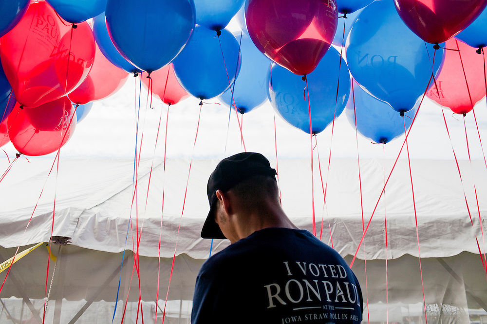 A volunteer for Republican presidential hopeful Ron Paul ties balloons to a barrier at the Iowa Republican Straw Poll on Saturday, August 13, 2011 in Ames, IA.