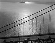Aerial of Golden Gate Bridge with fog reaching back to Alcatraz