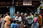 Women wait in line to get their quota of rations on 21st Oct 2006. The Indian government issue ration cards to low income families that can prove they have an address.