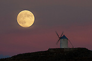 CONSUEGRA, SPAIN - SEPTEMBER 08: A moon appears behind a windmill a day before the supermoon is full on September 8, 2014 in Consuegra, in Toledo province, Spain. Consuegra belongs to a region made famous by the novel 'Don Quijote de la Mancha' (Don Quixote) writed by ' Miguel De Cervantes. Some of the windmills belong to the 16th century. (Photo by Pablo Blazquez Dominguez/Getty Images)