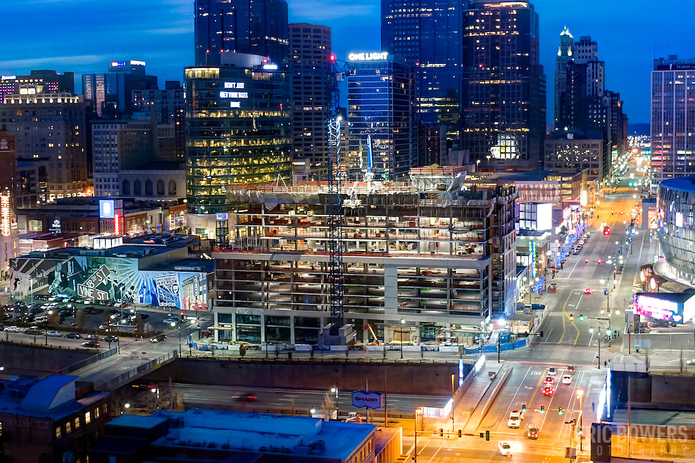 Kansas City, Missouri's downtown skyline at dusk with Two Light Tower residential construction in foreground.