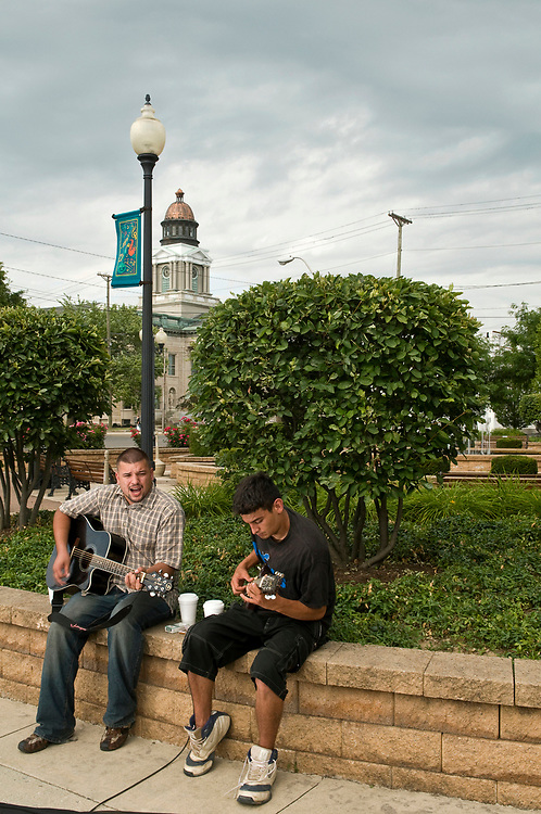 James Amos (left) and Damien Lucio pick out a tune in Bucyrus's Millenium Park on Wednesday, July 15, 2009. The rain held off and allowed the duo to play for over five hours.