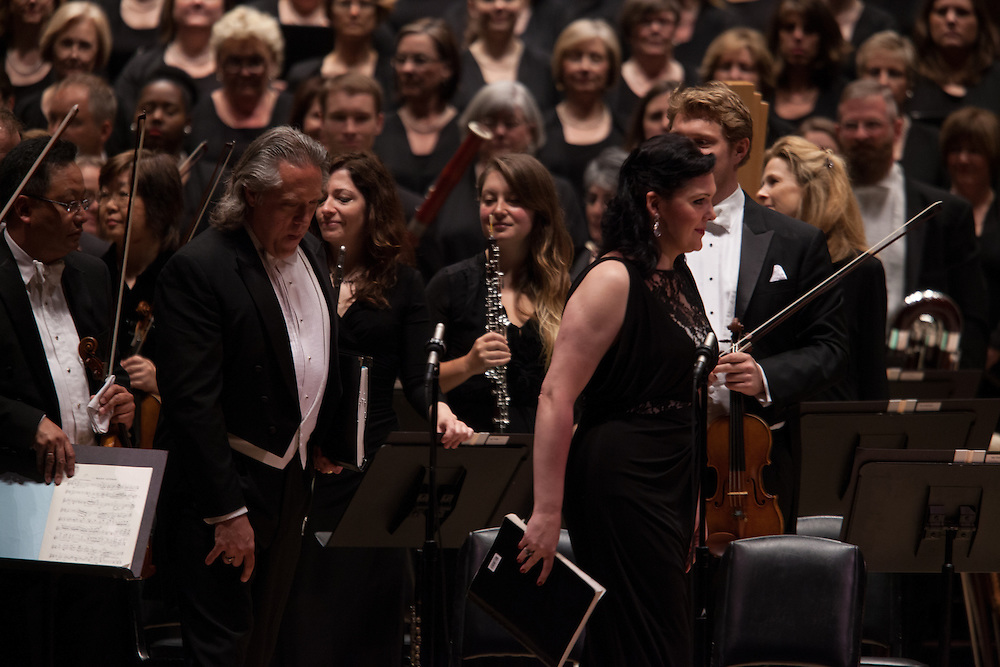 Baritone Stephen Powell, left, and Soprano Evelina Dobracheva walk on stage with the Atlanta Symphony Orchestra and Chorus performing Britten's War of Requiem at Carnegie Hall in New York, NY on April 30, 2014.