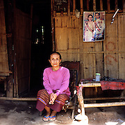 """Esther Htoo (56) is ethnic Karen from Insei town near Rangoon. She came to Mae La refugee camp in 2004, together with her two sons. She hopes that her family will be accepted by the US government to relocated there as refugees..Burmese refugee camp """"Mae La"""" is north of border-town Mae Sot and lies along the Thai-Burmese border on the side of Thailand. Approximately 50,000 people live there. 38,167 was the official number of registered people in November 2009, according to the Thailand Burma Border Consortium (TBBC), and the rest are unregistered or people who come and go."""
