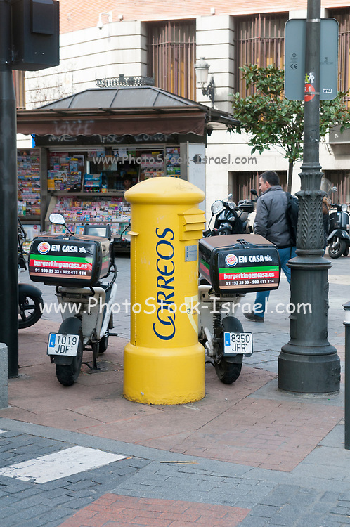 Yellow Spanish Post box. Photographed in Madrid, Spain