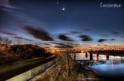 Sunset over the Missouri River, with the Broadway Bridge ahead and the moon and planet Venus overhead.