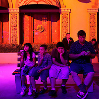 A family sits on a bench during a dance performance at Disneyland California Adventure in Anaheim, California on Wednesday, June 30, 2010.  Americans are hitting the road as summer vacations have begun and the economy is slowly improving(Photo by Sandy huffaker/Creative Business Wire)