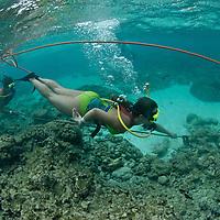 Tourist practicing Snuba, half snorkel and half diving