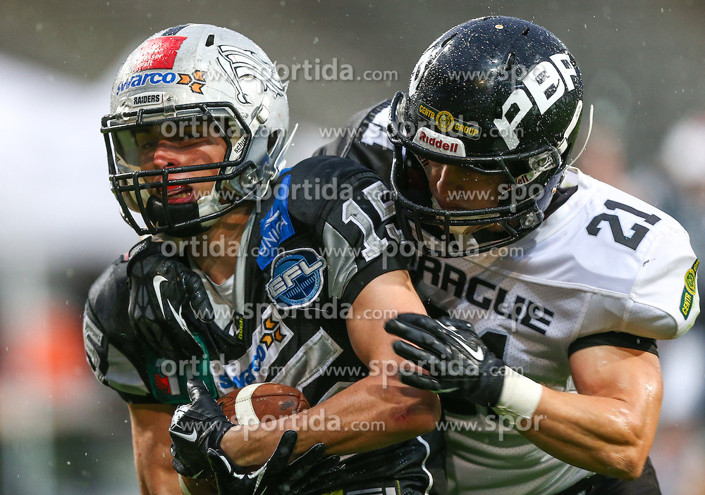 04.05.2013, Tivoli Stadion, Innsbruck, AUT, AFL, Swarco Raiders Tirol vs Prag Black Panthers, im Bild Simon Unterrainer, (SWARCO Raiders Tirol, WR, #15) und  Martin Hofman, (Prague Black Panthers, DB, #21)  // during the Austrian Football League Game between Swarco Raiders Tirol and Prague Black Panthers at the Tivoli Stadion, Innsbruck, Austria on 2013/05/04. EXPA Pictures © 2013, PhotoCredit: EXPA/ Thomas Haumer