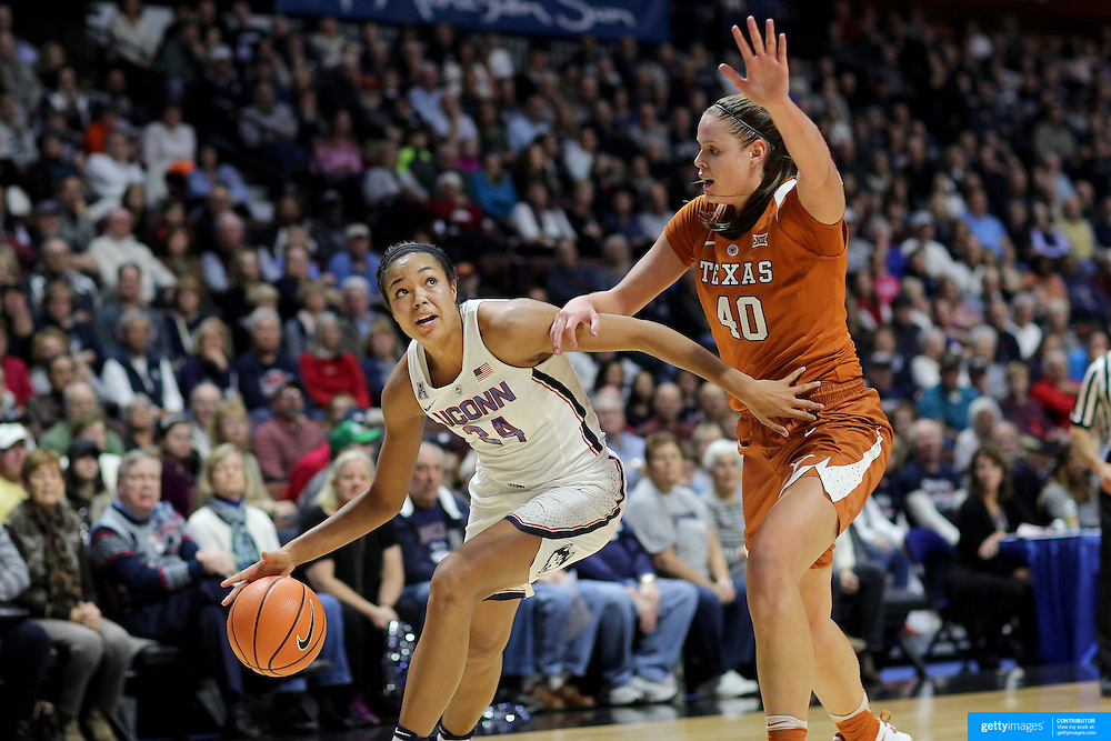 UNCASVILLE, CONNECTICUT- DECEMBER 4: Napheesa Collier #24 of the Connecticut Huskies defended by Kelsey Lang #40 of the Texas Longhorns during the UConn Huskies Vs Texas Longhorns, NCAA Women's Basketball game in the Jimmy V Classic on December 4th, 2016 at the Mohegan Sun Arena, Uncasville, Connecticut. (Photo by Tim Clayton/Corbis via Getty Images)