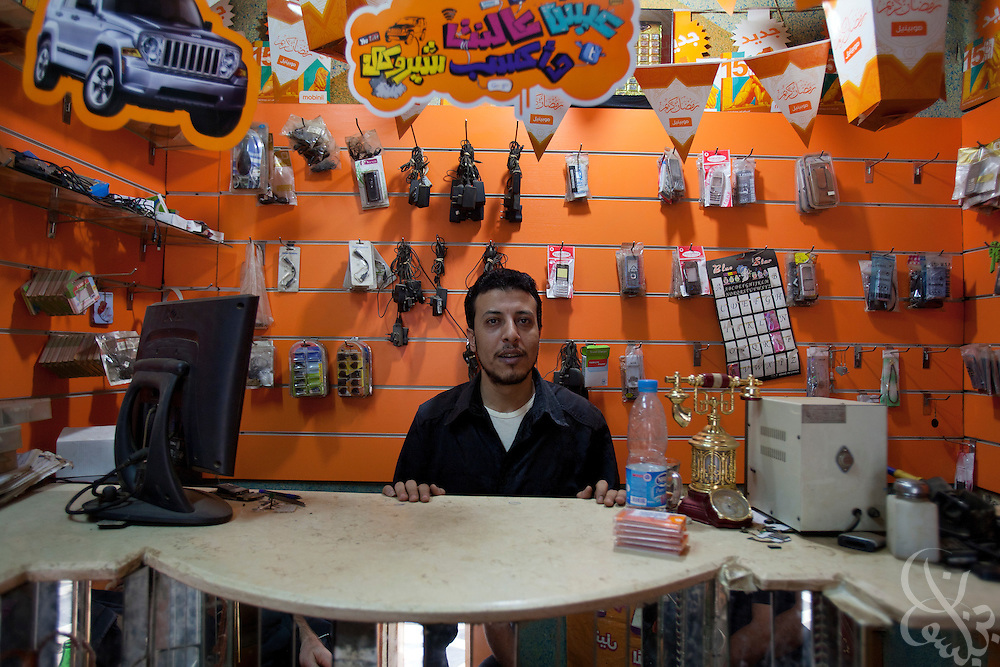 Ahmed Helmy, age 33, poses for a portrait inside his mobile phone shop October 27, 2011 in the Egyptian village of Warwara, just outside the Delta city of Benha around 50 kilometers north of Cairo.  (Photo by Scott Nelson)