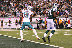 October 17, 2011; East Rutherford, NJ, USA; New York Jets cornerback Darrelle Revis (24) intercepts a pass intended for Miami Dolphins wide receiver Brandon Marshall (19) during the first half at the New Meadowlands Stadium.