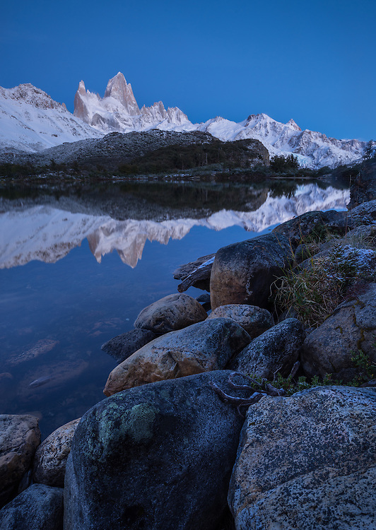 Fitz Roy reflecting in the twilight and calm waters of Laguna Capri, Los Glaciares National Park, Argentina