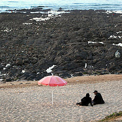 Families and couples gather at Sidi Abdel Rahman beach along the corniche in Casablanca, Morocco on May 7, 2009. The rocky island, accessible at low tide, is known to be the home of traditional healers and witchcraft practicers, where often believers will visit to improve their love lives.
