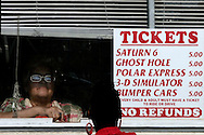 A vendor sells tickets at the Astroland Amusement Park in New York, May 27, 2007. The Coney Island amusement closes for goods at the end of the 2007 season ahead of a major redevelopment that will raze much of the lovably seedy boardwalk area. REUTERS/Keith Bedford (UNITED STATES)
