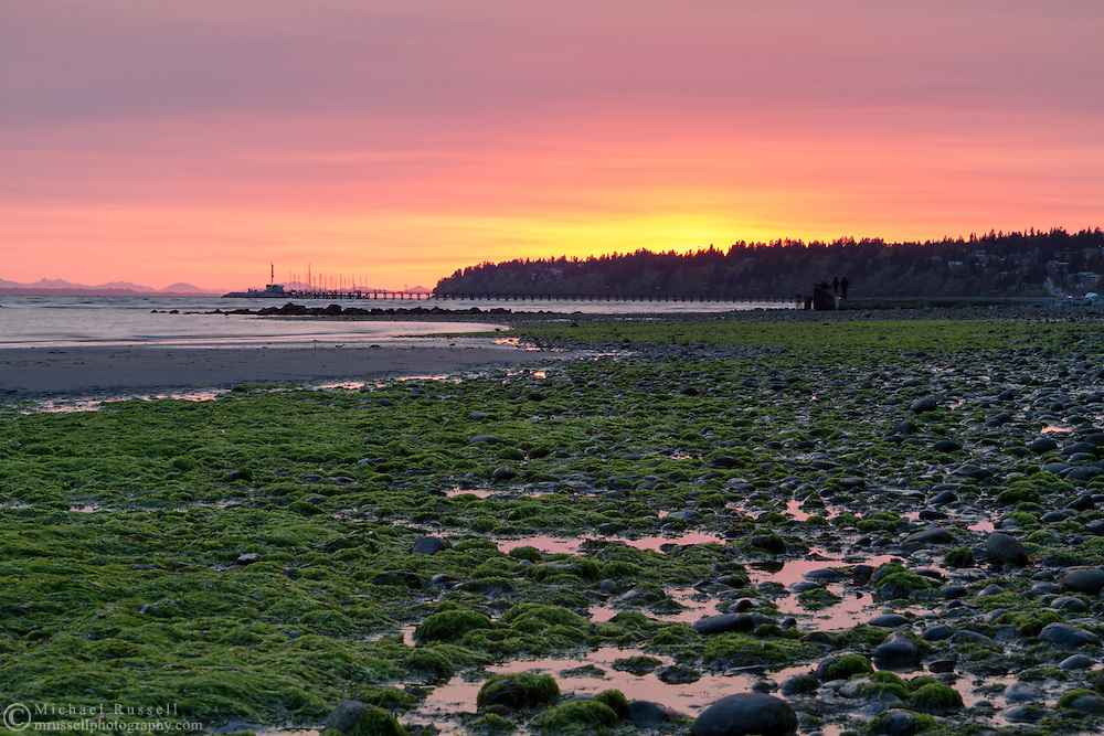 Sunset from the East Beach in White Rock, British Columbia, Canada. Air pollution or smoke from a recent fire in Squamish account for the atmospheric conditions.