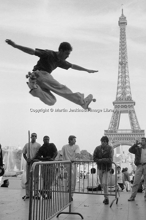 Roller skaters performing jumps near the Eiffel Tower, Plateau Joffre, Paris, France, June 1991