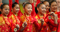 (L-R) China's Deng Linlin, Jiang Yuyuan, He Kexin, Li Shanshan, Yang Yilin, and Cheng Fei show their medals winning the gold for artistic gymnastics women's team during the Olympic games in Beijing, China, 13 August 2008. The Chinese won the gold medal for the event with the United States and Romania taking silver and bronze respectively.