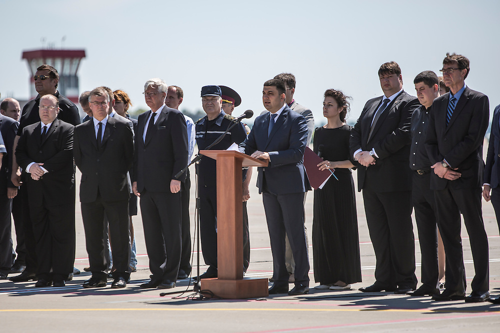 KHARKIV, UKRAINE - JULY 23: Volodymyr Groysman (C), Deputy Prime Minister of Ukraine, speaks at a departure ceremony for the victims of the crash of Malaysia Airlines flight MH17 to the Netherlands during a departure ceremony on July 23, 2014 in Kharkiv, Ukraine. Malaysia Airlines flight MH17 was travelling from Amsterdam to Kuala Lumpur when it crashed killing all 298 on board including 80 children. The aircraft was allegedly shot down by a missile and investigations continue over the perpetrators of the attack. (Photo by Brendan Hoffman/Getty Images) *** Local Caption *** Volodymyr Groysman