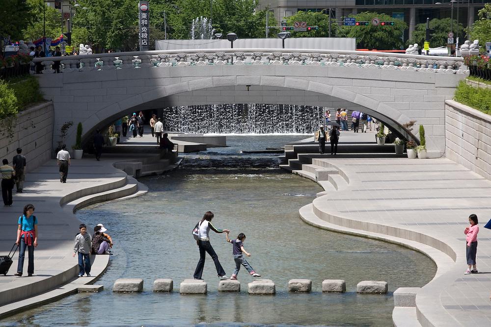 South Korea, Seoul,  Concrete pedestrian walkway and bridges over Cheong Gye Cheon Stream through center of city
