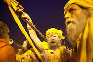 Naga Sadhus procession of Basant Panchami Snan. 15th of February, Allahabad. // The Maha Kumbh Mela is believed to be the single largest religious gathering in the world. It's a sacred pilgrimage celebrated every twelve years. In 2013 it has taken place in Allahabad, in the confluence of the rivers Ganga, Yamuna and Saraswati. Millions of hindu people gather on a single day for a ritual bath in the sacred waters of Ganga. The event congregate millions of devotees, sadhus and sadhvis of all the akharas coming from all over India.