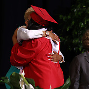 Christiana High School graduates receive their diplomas during Christiana's 52nd commencement exercises Monday, June 01, 2015, at The Bob Carpenter Sports Convocation Center in Newark, Delaware.
