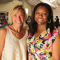Jennifer Salter, left, and Tammy Bennett pose for a photo during Fashion On Front Thursday August 21, 2014 at Bakery 105 in Wilmington, N.C.(Jason A. Frizzelle)