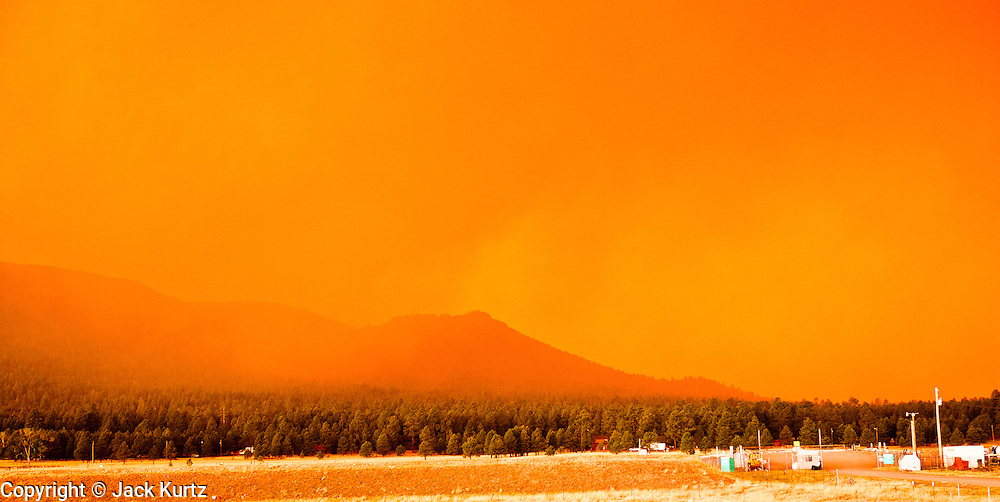 02 JUNE 2011 - ALPINE, AZ: Smoke from the Wallow Fire near Alpine turned the sky orange. High winds and temperatures complicated firefighters' efforts to get the blaze under control. Officials have issued a preliminary evacuation order warning residents to be ready to move in the next 12 hours.   PHOTO BY JACK KURTZ