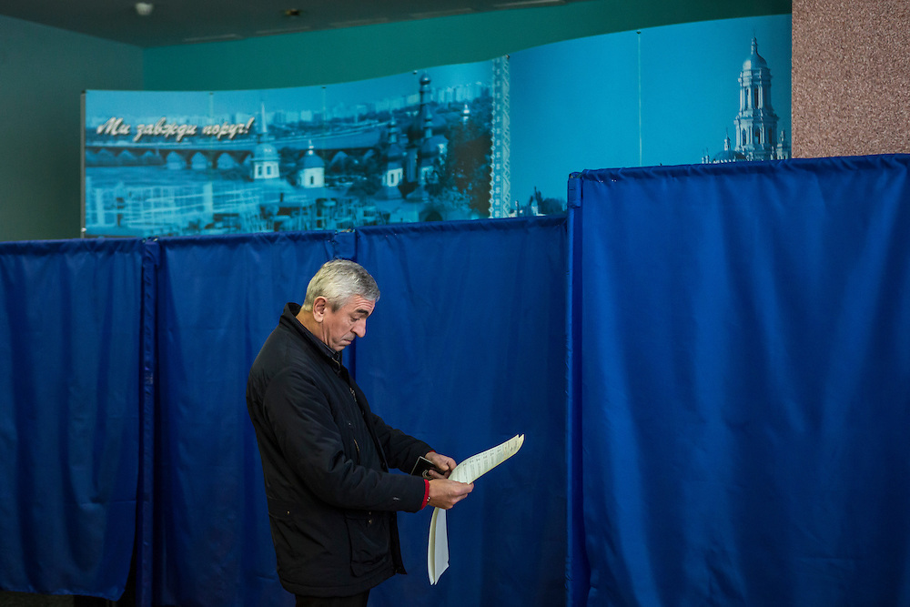 KIEV, UKRAINE - OCTOBER 26: A man looks over the ballot for parliamentary elections before casting his vote at a polling station on October 26, 2014 in Kiev, Ukraine. The country's parliamentary elections are seen as key to President Petro Poroshenko's ability to advance his agenda. (Photo by Brendan Hoffman/Getty Images) *** Local Caption ***