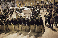 A squad of riot police surrounds a protester's camp the police forced to evacuate near the Presidential compound, on December 9, 2013 in Kiev, Ukraine. Thousands of protesters have taken to the streets since Ukrainian president Viktor Yanukovych announced a decision to suspend a trade and partnership agreement with the European Union and raised concerns that the nation could be poised to enter a customs union with Russia.