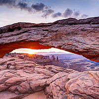 Sunrise in the Utah desert as seen through Mesa Arch, Canyonlands National Park.
