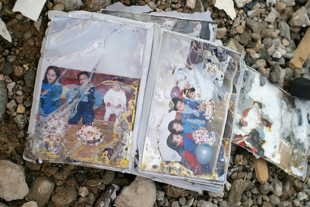 Birthday snapshots lie in the rubble of a flattened apartment complex in the Hezbollah stronghold of Haret Hriek, South Beirut.