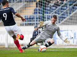 Falkirk's Lyle Taylor in on Morton's keeper David Hutton..Falkirk 4 v 1 Morton, 4/5/2013..© Michael Schofield..