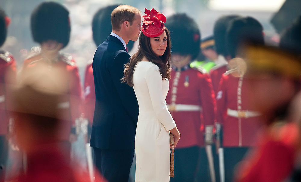 Catherine the Duchess of Cambridge looks over her shoulder as she and Prince William arrive on Parliament Hill in Ottawa, Canada, for  Canada Day celebrations July 1, 2011. The duke and Duchess are on a nine day tour of Canada, their first official foreign trip as husband and wife.<br /> AFP PHOTO/GEOFF ROBINS