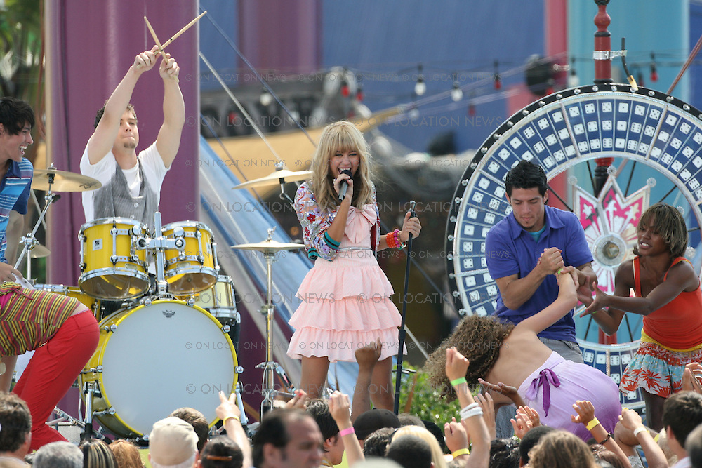 SANTA MONICA, CALIFORNIA - WEDNESDAY 16TH JULY 2008 NON EXCLUSIVE: Miley Cyrus performs as Hannah Montana while filming a concert scene for her movie being filmed at The Santa Monica Pier. Miley Cryus also filmed scenes with her father  Billy Ray Cyrus and Vanessa Williams Photograph: On Location News. Sales: Eric Ford 1/818-613-3955 info@OnLocationNews.com