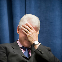 An agreement between the Department for International Development (DFID), the Governments of Rwanda and Malawi and Band Aid/The Hunter Foundation, and managed by the Clinton Hunter Development Initiative (CHDI) was launched at the DFID offices in London. Photo shows former US President Bill Clinton with his head in his hands.
