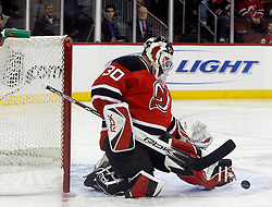 February 8, 2008; Newark, NJ, USA;  New Jersey Devils goalie Martin Brodeur (30) makes a save during the first period of the Devils game against the Anaheim Ducks at the Prudential Center in Newark, NJ.