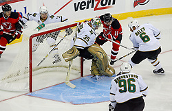 Oct 22, 2008; Newark, NJ, USA; New Jersey Devils center John Madden (11) looks for a rebound after a save by Dallas Stars goalie Marty Turco (35) during the first period at the Prudential Center.