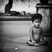 A Cambodia child is used as a beggar in Phnom Penh.