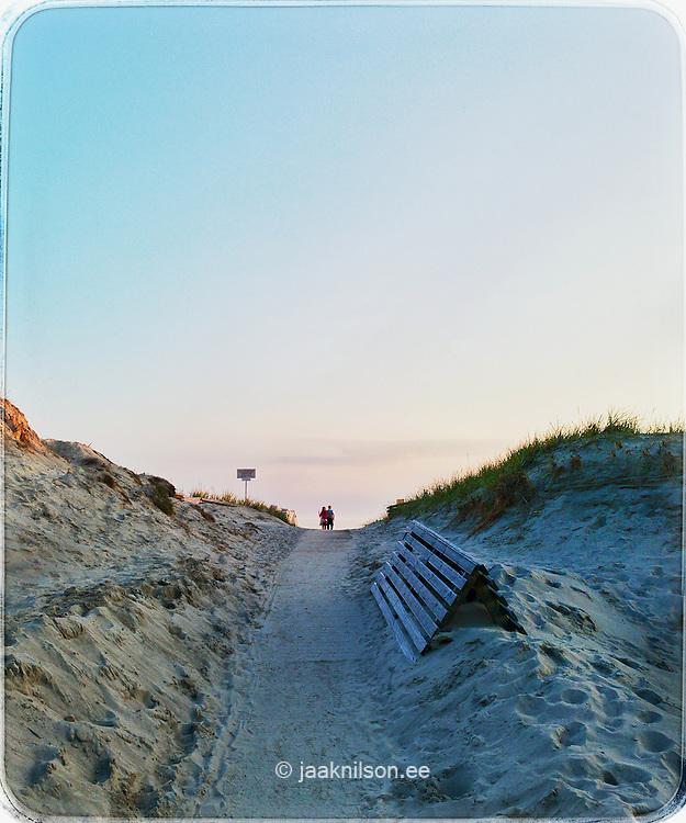 Two people walking. Sand dunes in Pärnu, Estonia