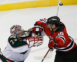 Mar 20, 2009; Newark, NJ, USA; Minnesota Wild goalie Josh Harding (29) makes a shaft save while New Jersey Devils center Travis Zajac (19) sets a screen during the third period at the Prudential Center.  The Devils defeated the Wild 4-0.