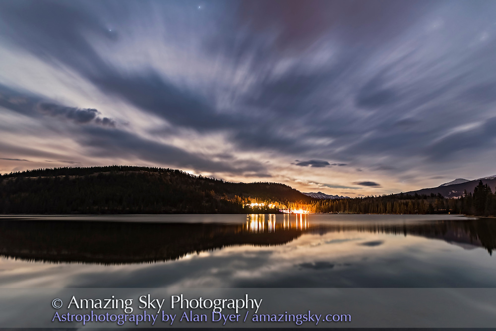 The waxing Moon rising amif clouds over Pyramid Lake and Pyramid Lake Lodge in Jasper National Park, Alberta, Canada, on October 19, 2016. Taken at the end of a time-lapse shoot from the last beach picnic site. <br /> <br /> This is a stack of 4 exposures, mean combined to smooth noise and blur cloud motion. Each 20 seconds at f/2 with the Sigma 20mm lens and Nikon D750 at ISO 1600.