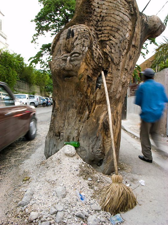 A carving on a tree in Pettionville, Haiti. 9/9/08 Photo by Ben Depp