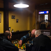Men play chess in a Lithuanian Restaurant near the railway station in Vilnius, Lithuania