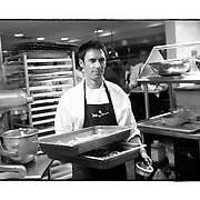 SHOT 1/11/11 3:49:31 PM - Chef Matthew Perez carries ingredients for a family meal of lasagna for the employees of Frasca Food and Wine in the Boulder, Co. restaurant. Frasca is a highly-rated neighborhood restaurant inspired by the cuisine and culture of Friuli, Italy. Historically found throughout Friuli, Frascas were friendly and informal gathering places, a destination for farmers, friends, and families to share a meal and a bottle of wine. Identified by a tree branch hanging over a doorway portal, they were a symbol of local farm cuisine, wine, and warm hospitality. (Photo by Marc Piscotty / © 2011)