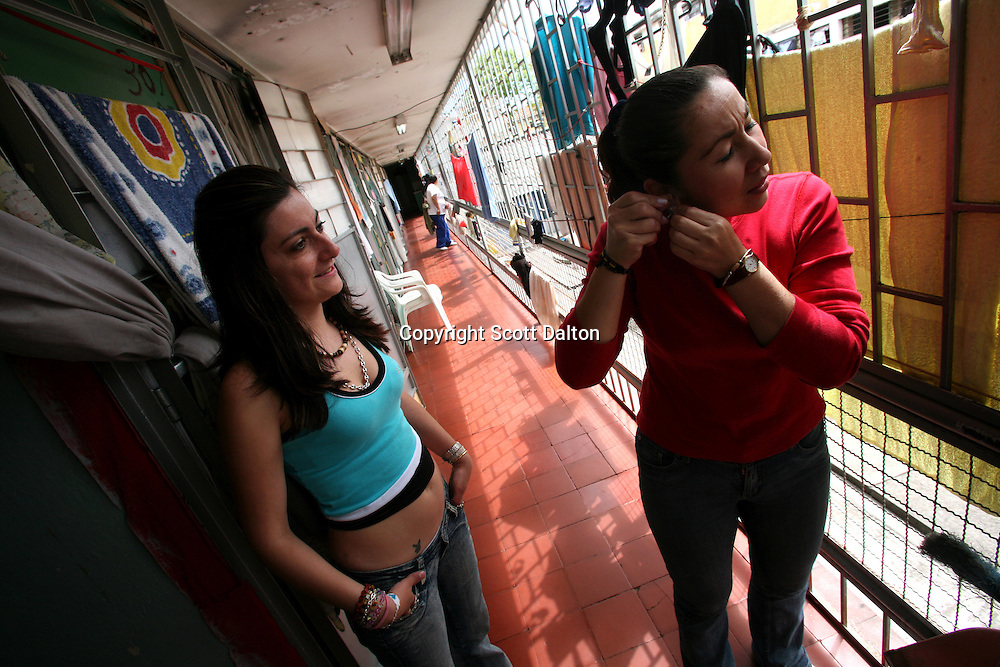 Inmates get prepared to go to the beauty pageant at the Good Shepard Prison, a female prison, in Bogotá, Colombia on Thursday, September 20, 2007. Each September, the female inmates of the Good Shepherd Prison hold a beauty pageant in honor of the Virgin of Mercedes, the patron saint of prisoners. Good Shepherd is the largest female prison in Colombia with over 1,000 inmates. (Photo/Scott Dalton).
