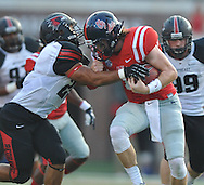 Mississippi quarterback Bo Wallace (14) is tackled by Southeast Missouri State's Matt Starks (25) at Vaught-Hemingway Stadium in Oxford, Miss. on Saturday, September 7, 2013. (AP Photo/Oxford Eagle, Bruce Newman)