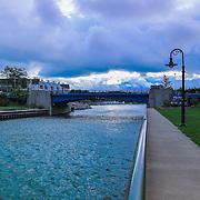 &quot;Charlevoix Drawbridge 2&quot;<br /> <br /> Beautiful blue waters and dark skies as you walk towards the drawbridge in Charlevoix Michigan!
