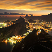 View at dusk from Sugar Loaf Mountain over the city of Rio, with Corcovado and Christo in the distance, Rio de Janeiro, Brazil, South America (m)